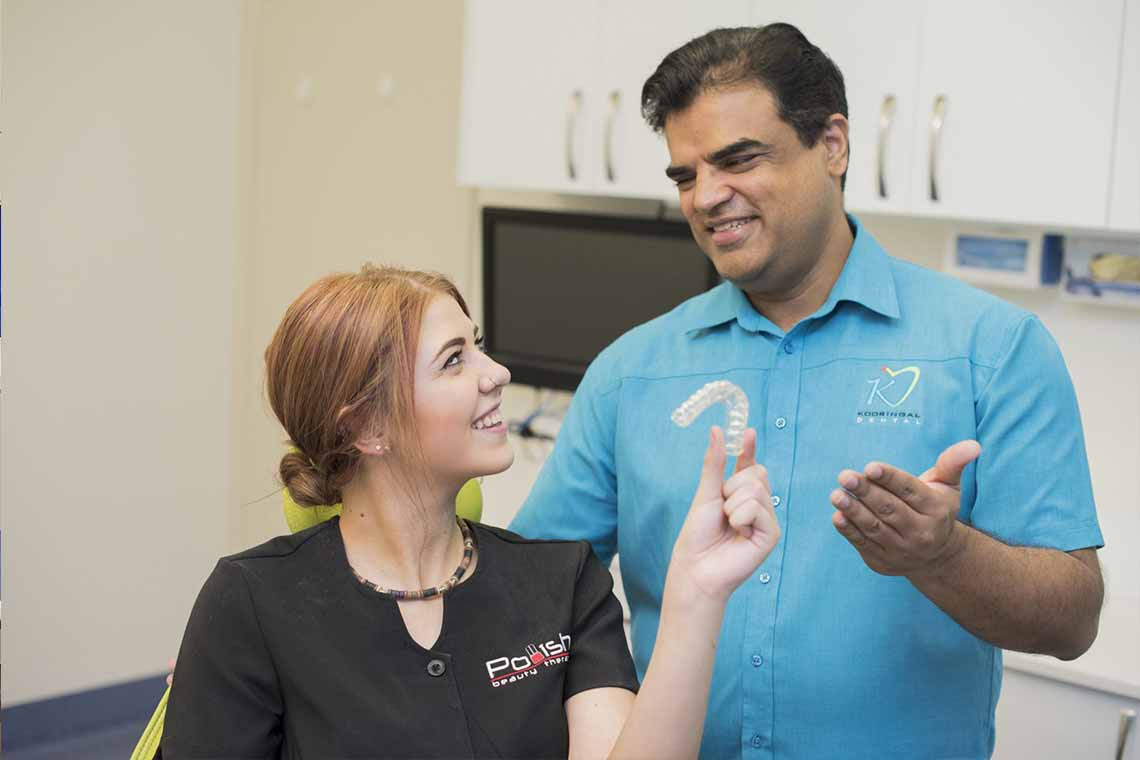 dentist showing Invisalign Wagga Wagga to a patient