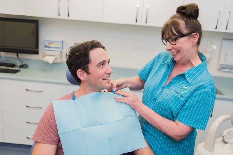 Dentist with Patient for checkup