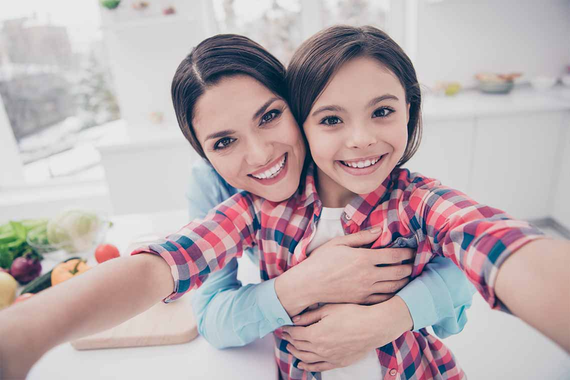 happy smiling mother and daughter photo