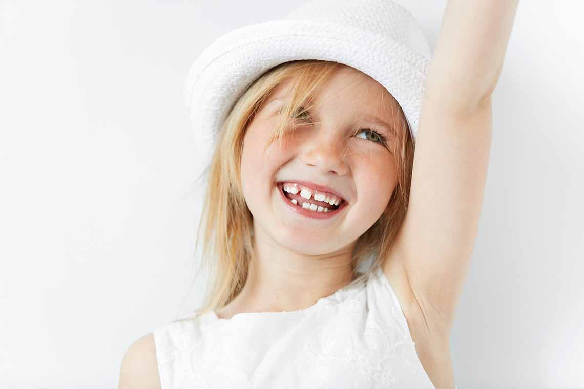 Children smile after orthodontist checkup