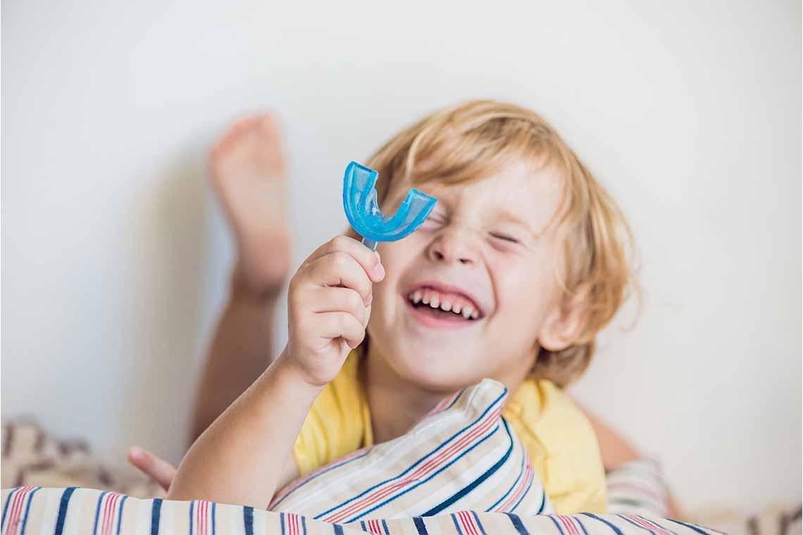Kids mouthgaurd in hand