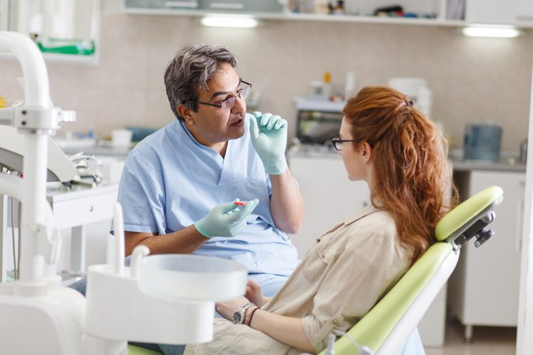 Dentist with patient cosmetic dentist explaining