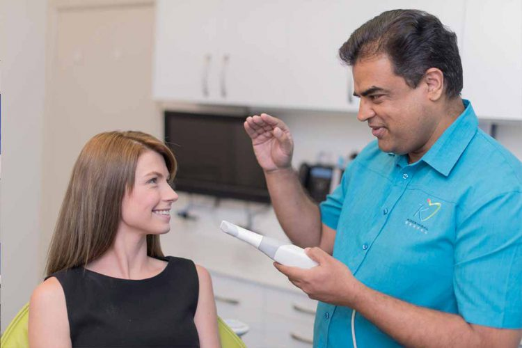 Dr Cherian Thomas examine patient for dental care